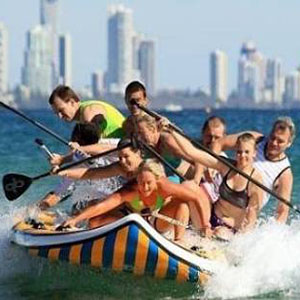 9 paddlers riding a giant inflatable SUP